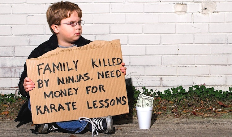 A young boy collecting funds for karate lessons
